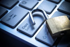 a padlock on a keyboard representing cyber liability insurance