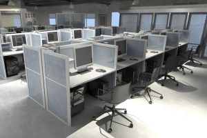 cubicles in an office with technology insurance