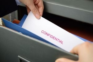 employee of a company stealing confidential information