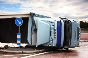 overturned semi truck carrying equipment covered by staging and rigging insurance