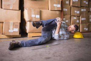 post office with business insurance where an employee slipped and broke his knee